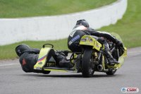 Yamaha Twin Vintage sidecar two-wheel drifts through turn two during VRRA Friday practice. [Photo: Colin Fraser]