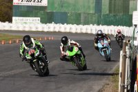 Running up front in Amateur Superbike at Shannonville's RACE Regional SuperSeries opener were Maxime Moldvar (Kawasaki # 511), Jared Walker(Kawasaki # 14), Todd Ferguson (Honda # 74) and Richard Diaz. [Photo: Colin Fraser]