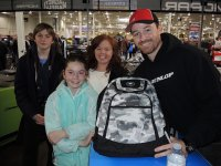 Sydney from Toronto, lower left, is joined by her family as she receives her Ogio backpack courtesy of Motovan from Mopar CSBK Snow City/Lucas Oil Kawasaki pilot Derrick Whyte, right. [Photo: Colin Fraser]