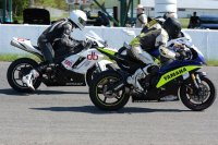 First Amateur Superbike start at Shannonville and 600cc stars (L to R) Christ Brent (Kawasaki), Steve Hamer (Yam) and partially hidden Mike Raniowski (Suz) leave the start line.[Photo: Colin Fraser]