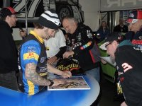 Reigning Mopar CSBK National Superbike Champion Jordan Szoke, left, does his autograph duty during a Saturday afternoon session at the Motorama Show in Toronto on Saturday, March 11. [Photo: Colin Fraser]