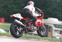 Duhamel's efforts aboard the new Harley-Davidson VR1000 twin Superbike in 1994 are legendary, as this shot from the National at Mid-Ohio suggests. [Photo: Colin Fraser]