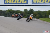 VRRA's Period Four showcases the most modern machines in the VRRA, including the Suzuki GSX-Rs and Ducati Desmo Twins pictured entering turn two at Canadian Tire Motorsport Park. [Photo: Colin Fraser]