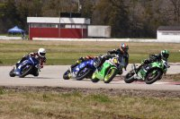 While Sebastien Tremblay ran away in Liqui Moly Pro Sport Bike action at Shannonville, a great battle developed for second between Nico Meunier (Kawasaki # 112), Louie Raffa (Honda # 76), reigning National Champ Tomas Casas (Yamaha # 1) and returning ace Will Hornblower (Yamaha # 47).  At the finish, Casas just edged arch-rival Hornblower for second in the National warm-up event. [Photo: Colin Fraser]