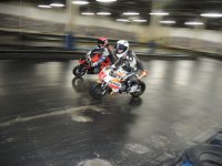 Kenny Riedmann (closest to the camera) dices with reigning Mopar CSBK National number one Ben Young during Mini-Indy test action with the Ohvale line of race bikes. [Photo: Colin Fraser]